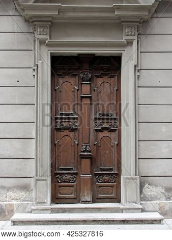 Old Wooden Closed Entrance Door Exterior With Stone Facade Wall