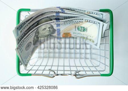 Hundred Dollar Bills In Shopping Basket Closeup