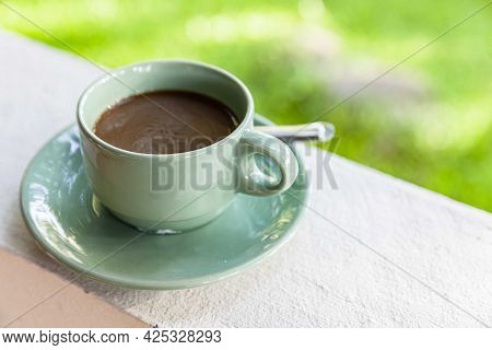 A Hot Americano Coffee Cup On The Table Inside A Modern Cafe