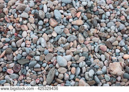 Small Beach Pebbles, Smooth Pebbles On The Sea Beach, Mediterranean Sea, Background