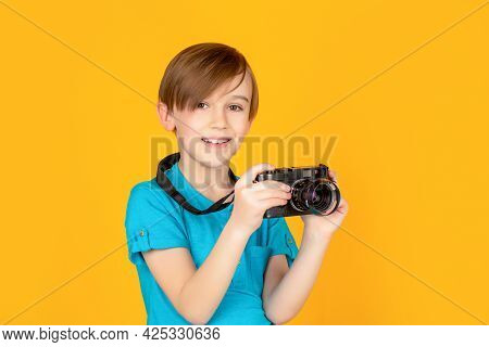 Baby Boy With Camera. Cheerful Smiling Child Holding A Cameras. Little Boy On A Taking A Photo Using
