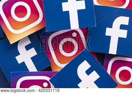 London, Uk - June 2021: Facebook And Instagrm Logos Printed Onto Paper