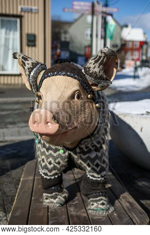 A Pig Statue Dressed In Traditional Icelandic Wool Sweater, In Front Of Saeta Svinid Gastropub, Reyk
