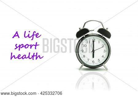 Retro Alarm Clock On A White Background. Black Alarm Clock Showing 6 Hours 00 Minutes On A White Bac
