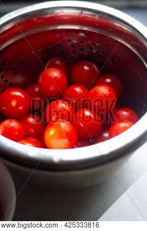 Fresh Cherry Tomatoes In Bowl. Healthy Food, Cooking At Home. Tomatoes Salad Background