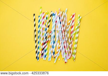 Biodegradable Paper Eco Straws. Zero Waste Straws On Yellow Background. Copy Space For Text.