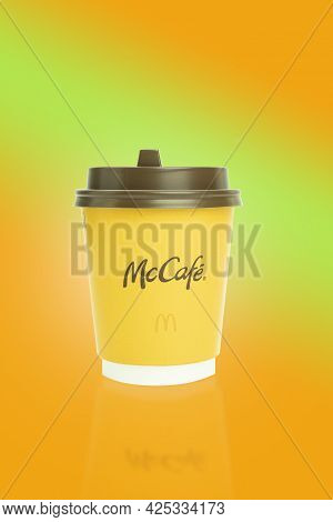 Poland, Warsaw - April 26, 2021: Yellow Paper Cup With Coffee, From Mcdonald's. Background With Copy