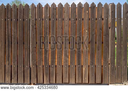 Fragment Of A Wooden Plank Fence With Metal Rivets. Security Concept. Background With Copy Space.