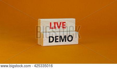 Live Demo Symbol. Concept Words 'live Demo' On Wooden Blocks On A Beautiful Orange Background. Copy