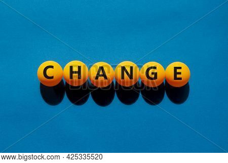 Change And Business Symbol. The Concept Word 'change' On Orange Table Tennis Balls On A Beautiful Bl