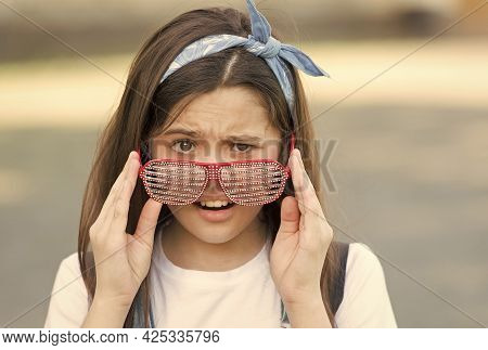 Outraged Little Girl Taking Off Sunglasses, Party Is Over Concept