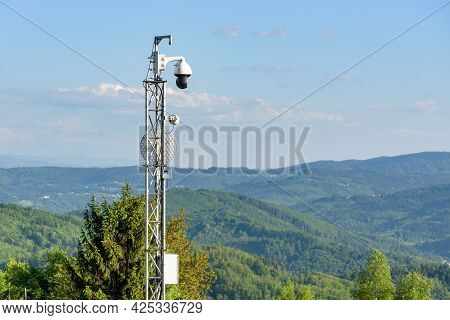 Webcam And Antenna On The Mast In The Mountains
