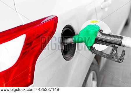 Refueling The Car With Gasoline.refueling The Car With Gasoline