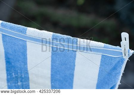 A Towel Fixed With A Clothespin Is Dried On A Rope