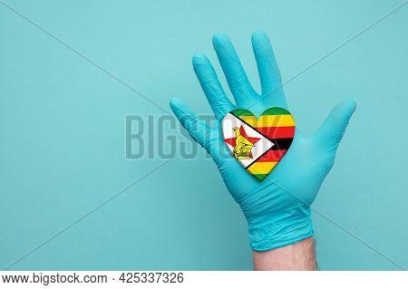Zimbabwe Medical Health Heart. Nurse Hand Holding Country Heart Flag