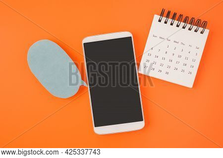 White Mobile Phone With Clipping Path On Touchscreen, Opened Calendar And Speech Bubble On Vivid Ora