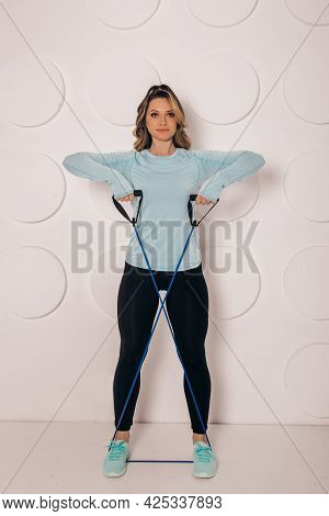 Close Up Photo Of Muscular Woman Legs On White Background. Woman Bodybuilder Buttocks