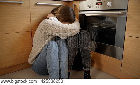 Pov Of Angry Person Moving Towards Two Afraid Girls Crying On Floor And Hugging. Concept Of Domestic
