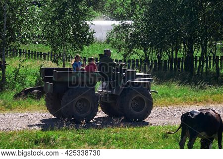 Cape, Russia - June 20, 2021: Villagers Rides A Makeshift Swamp Buggy Through The Village