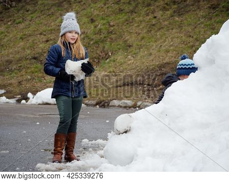 Winter Fun. Cheerful Child In A Hat Plays Snowballs