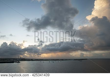 The View Of Picturesque Clouds During The Sunrise Over Grand Turk Resort Island (turks And Caicos Is