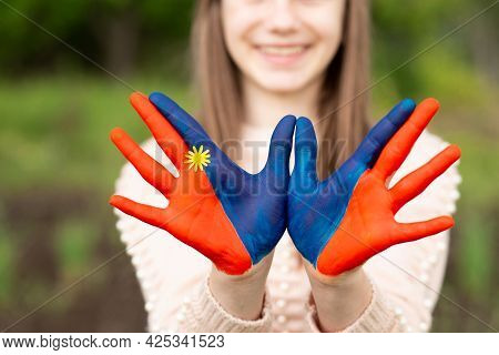 Hands Of Kid Girl Painted In Mongolia Flag Color. Focus On Hands. July 10 National Flag Day. Mongoli