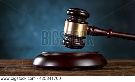 Gavel being struck to decide an auction or guilty verdict in court.