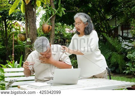 Elderly Asian Men Are Choking On Drinking Water. Tight, Suffocating In The Neck And Chest Area. His