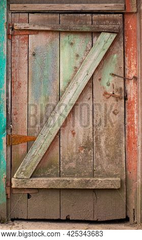 Old Wooden Door With The Letter Z Outside. Entrance To An Old Building With A Mystical And Mysteriou