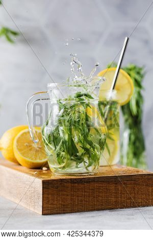 Refreshing Homemade Lemonade With Tarragon And Lemon In A Jug. Summer Drinks.