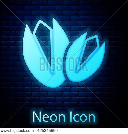 Glowing Neon Pistachio Nuts Icon Isolated On Brick Wall Background. Vector