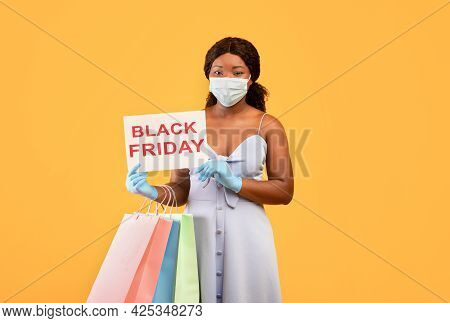Black Woman Wearing Face Mask, Holding Black Friday Sign, Holding Shopping Bags, Purchasing Things D
