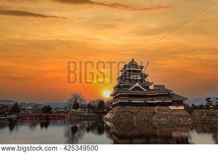 Old Castle In Japan. Matsumoto Castle Against Sunset Sky In Nagono City, Japan. Castle In Winter. Tr