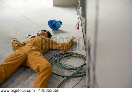 Electrician Worker Accident Electric Shock Unconscious In Site Work. First Aid Technician Worker Acc