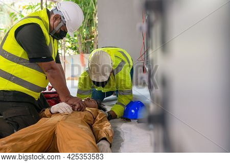 Safety Team Cpr For First Aid Electrician Worker Accident Electric Shock Unconscious. Asian Electric
