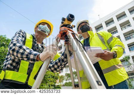 Surveyor Team Civil Engineer Working With Surveyor Telescope Equipment At Building Site. Team Engine