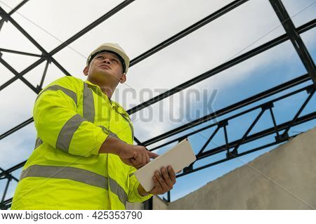 Professional Civil Engineer Wearing Safety Helmet And Holding Tablet Inspection Check Detail Roof St