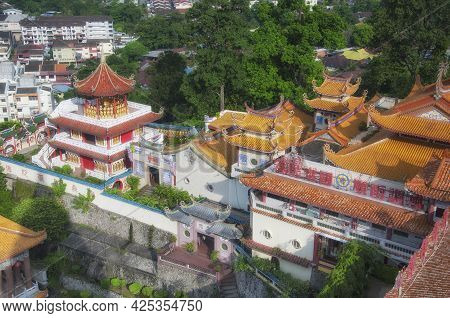 Penang, Malaysia. August 20, 2017. A Gazebo With Many Buddha Statues And Various Architecture Within