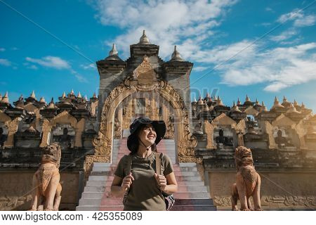 Portrait Asian Woman Traveler Happy Tourism With Pagoda Of Buddhist Temple In Background. Travel Sou