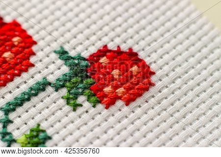 Red Ripe Strawberries Embroidered With A Cross-stich On A White Canvas By Hand. Close Up, Macro. Hob