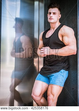 Handsome Fit Young Man In Black Tank-top, Outdoor In City