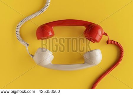 Top View Vintage Telephone Receivers With Cord. High Quality Beautiful Photo Concept