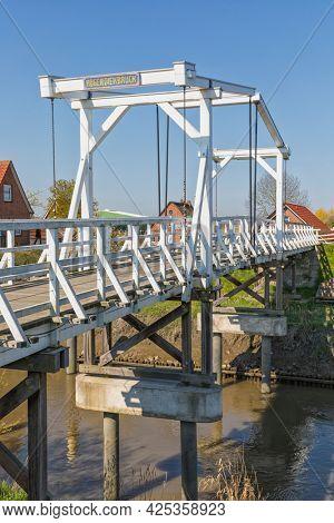 Wooden dutch drawbridge across Lühe river at Altes Land region of Lower Saxony, Germany