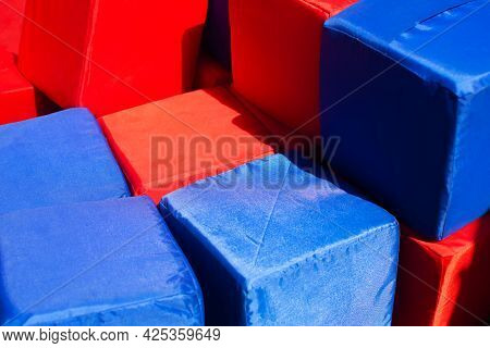 Red And Blue Soft Rag Cubes In The Childrens Playroom