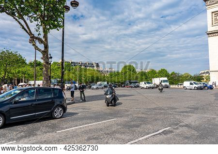 19 June 2019 - Paris, France: Traffic On Champs Elysees Avenue In A Summer Morning