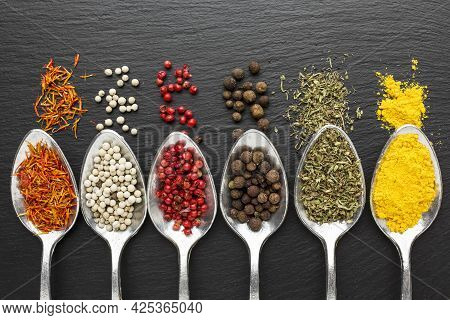 Top View Spoons With Powder Condiments. High Quality Beautiful Photo Concept