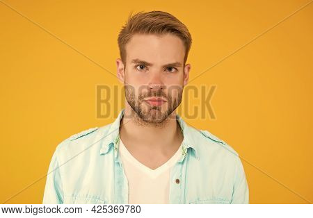 Handsome Unshaven Man With Bristle. Male Summer Casual Fashion Style. Serious Guy Has Groomed Hair O
