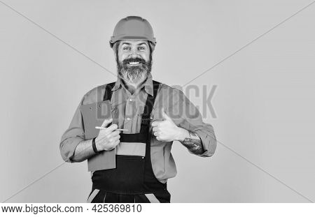 Control Concept. Foreman With Document. Delivering Building Materials. Man In Hard Hat Holding Clipb