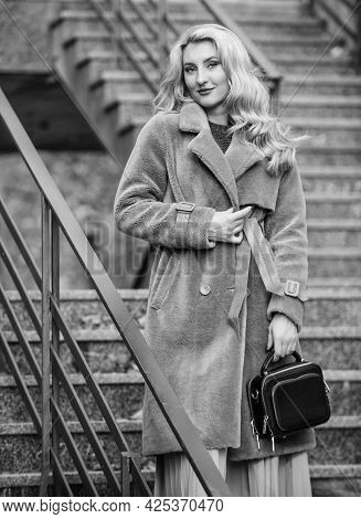 Any Weather Is Good. Autumn Season. European Winter. Girl Warm Coat Stairs Background. Faux Fur Coat