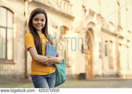 Back To School. Happy Kid With Notebook. Education For Children. Schoolgirl Carry Backpack. Happy Ch